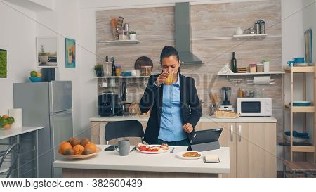 Businesswoman Rushing At The Office During Breakfast. Young Freelancer Working Around The Clock To M