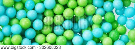 Green And Blue Eatable Sugar Pearls For Food Decoration. Panoramic Image