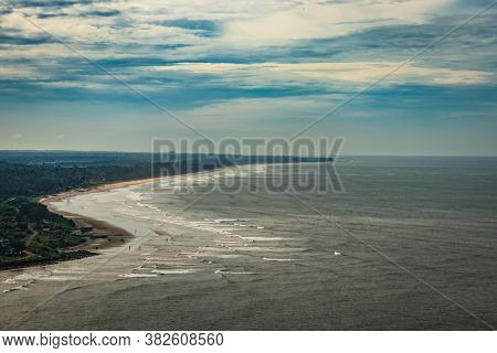 Beach Isolated In Aerial Shots With Dramatic Sky