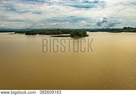 Sea Backwater With Mangrove Forest And Bright Sky