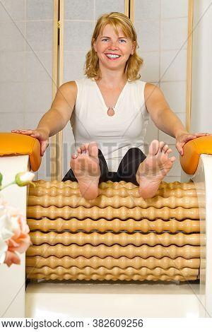 Woman Making Massage For Leg Femur. Roll Massage Machine Is A Way To Shape The Figure. Skin Care, Bo