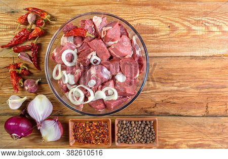 Boneless Lamb Steak, Sliced And Marinated With Onions, Meat In A Glass Bowl, Basil, Chili Peppers, M