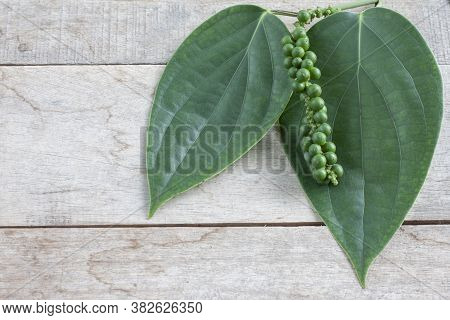 Fresh Green Peppercorns Or Piper Nigrum Linn With Leaf On Wooden Table Background, Is An Ingredient