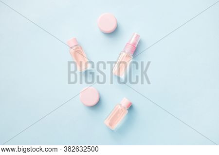 Flat Lay Of Flowers And Cosmetics Products Essential Oil: Toner, Serum, Essence, Moisturizer And Oth