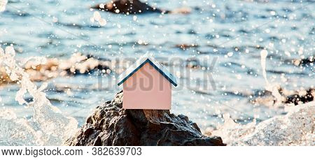 Waterside House. Property Acquisition. Real Estate Market. Wooden House On Sea Shore Mockup. Sea Bre