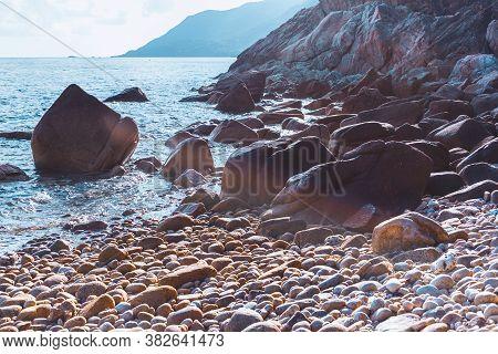 Empty Stone Beach Bay On Tropical Island