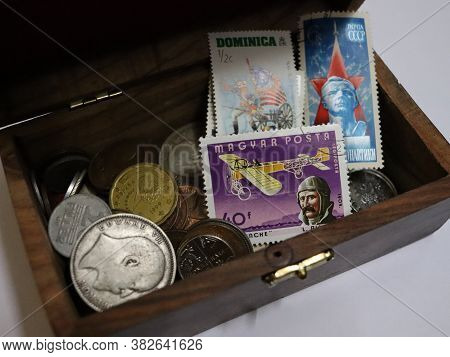 Prayagraj, Uttar Pradesh/india- May 12 2020: A Vintage Box Of Old Coins And Rare Stamps Collected By