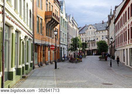 Alesund, Norway - July 27, 2020: People Visit Old Town In Alesund City. Alesund Is The Largest Town