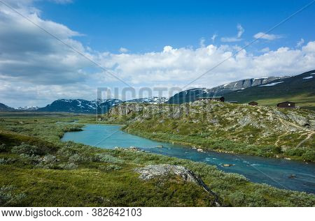 Swedish Lapland landscape. Arctic environment of Scandinavia in summer sunny day. Alesjaure mountain cabins on Kungsleden and Nordkalottruta Arctic hiking Trail in northern Sweden
