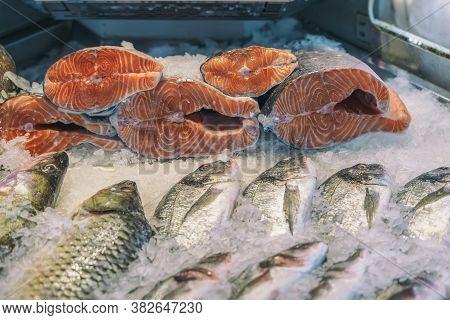 Sale Of Fresh Frozen Fish On Farmers Bazaar. Open Showcases Of Seafood Market. Fish Store. Fresh Sal