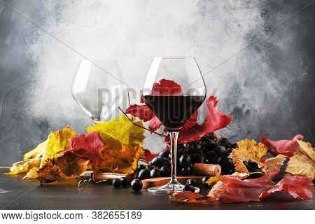 Red Wine In Wine Glass, Autumn Still Life With Red And Yellow Leaves, Wine Tasting, Copy Space, Sele