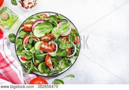 Spring Vegan Salad With Spinach, Cherry Tomatoes, Corn Salad, Baby Spinach, Cucumber And Red Onion.
