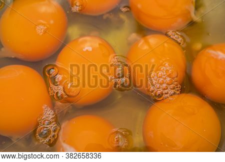 Background Image Of Egg Yolk In A Bowl.