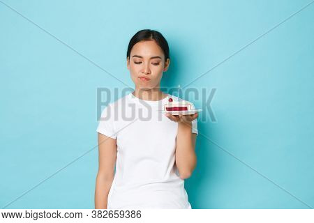 Holidays, Lifestyle And Celebration Concept. Skeptical And Disappointed Asian Girl In White T-shirt,