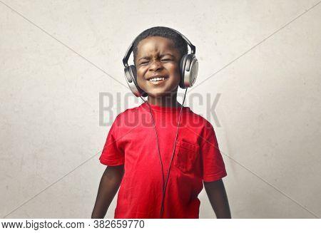 portrait of child listening to music