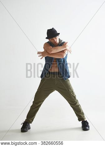 Cool Young Guy Breakdancer In Hat Dancing Hip-hop In Studio Isolated On White Background. Break Danc