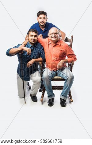 Indian Asian Senior Man With Kids While Sitting On Rocking Chair