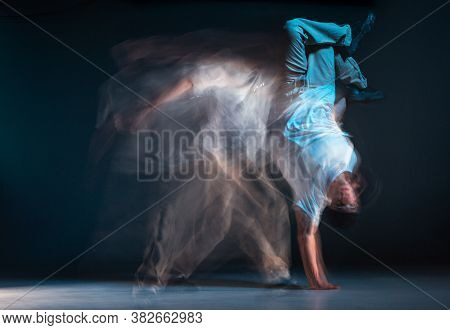 Young Man Breakdancer Dancing Hip-hop In Neon Light. Dance School Poster. Long Exposure Shot