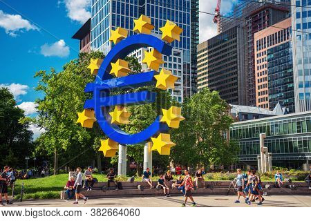 Frankfurt, Germany - June 12, 2019:  Tourists in the pedestrian zone of the European Central Bank, Frankfurt