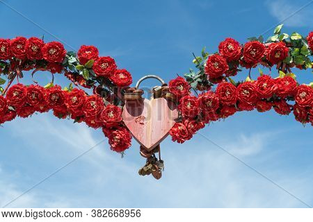 Symbolic Padlock In The Shape Of A Heart On A Clear Sky. Eternal Love And Symbolic Concepts Or Ideas