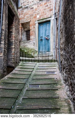 Old Italian Red Front Door In The City Of Urbino, Italy