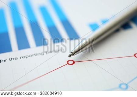 On Table Is Financial Report With Chart And Pen. Enterprise Performance Data. Key Business Indicator