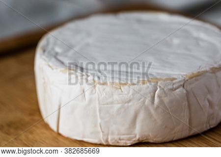 Fresh French Brie Cheese On Wooden Board