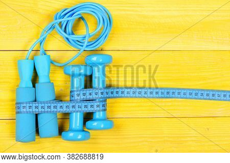 Gym And Workout Concept. Sports Equipment In Cyan Blue Color