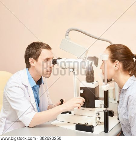 Eye Doctor Exam Patient Pressure Heath. Ophthalmology Concept. Astigmatism Diagnosis At Clinic. Eyec