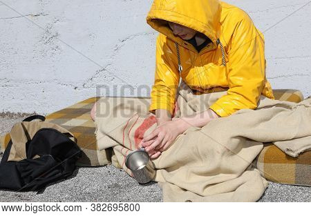 Young Homeless People Begging Passersby On The Street