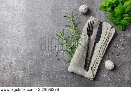 Cutlery Set. Stylish Black Cutlery And Napkin With Spice. Top View. Copy Space.