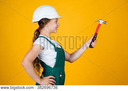 Look At That. She Is Good Assistant. Kid Engineer With Carpenter Work Hammer. Labor Day At 1 May. Li