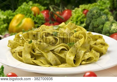Cooked Italian Fettuccine Pasta With Pesto Sauce