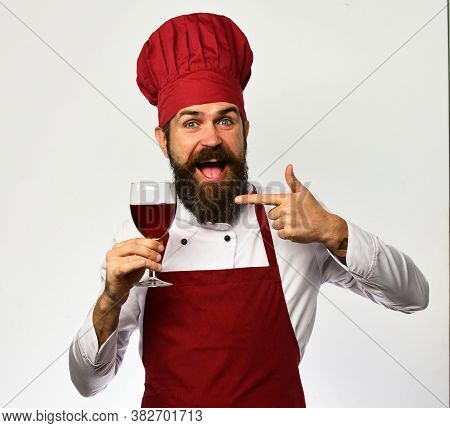 Chef Or Sommelier With Red Cabernet Or Merlot.