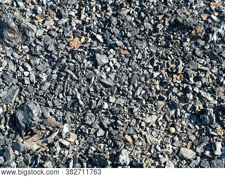 Lumps Of Black Coal On The Surface Of The Earth. Coal Mining Industry. Underground Resources Of The