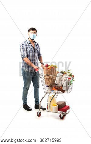 Indian Asian Young Man Wearing Face Mask And Pushing Shopping Trolly Or Cart