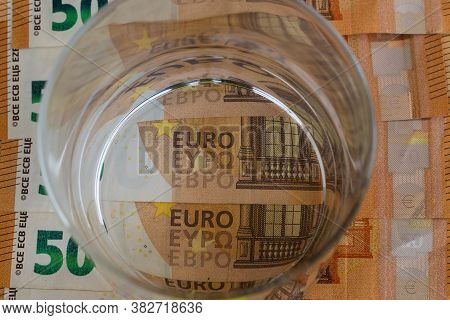 Glass Of Water On Top Of Fifty Euro Banknotes, Economy Concept