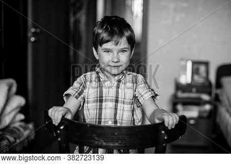 Portrait of a five year old boy. Black and white photography.