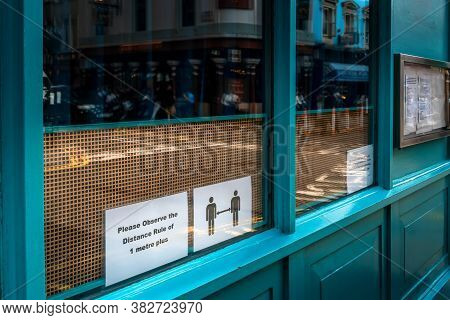 Social Distance Guidelines On Sign At Restaurant Window During Covid In London, Uk
