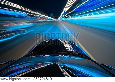 View From Roof Of A Black Car Moving In A Night City, Blured Road With Lights With Car On High Speed