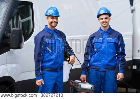 Pest Control Exterminator Service Workers Near Van Car