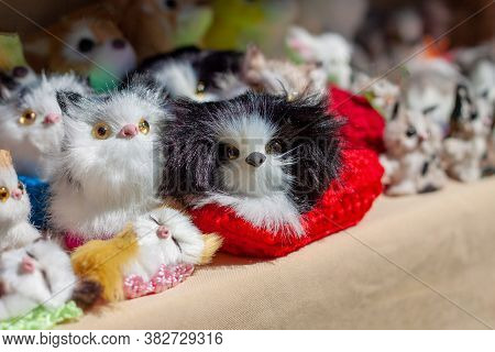 Many Little Fluffy Creatures In A Red Wicker Basket On The Souvenir Counter.  The Sun Shines Brightl