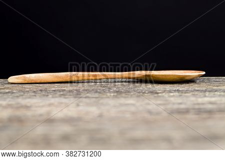 A Few Simple Wooden Spoons Made Of Natural Wood, A Close Up Of Useful Items In Cooking And Other Act