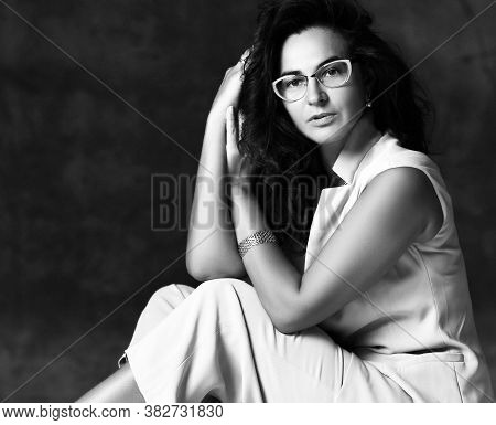 Charming Woman In Seat Position Leaned Head On Folded Hands Palm Wearing Trendy Fashion Eyeglasses T