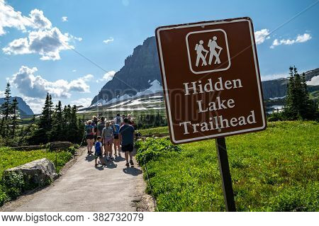 Montana, Usa - July 28, 2020: Crowds Of Hikers Gather At The Hidden Lake Trailhead, A Very Popular E