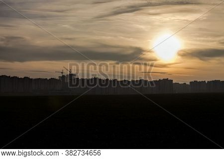 Landscape During Sunset Or Dawn With Different Colors In The Sky And The Sun That Hides Behind The H
