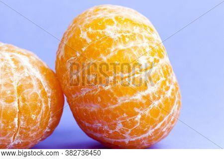 Flesh Of Sweet And Ripe Orange Close-up, Useful Citrus Fruit, Orange On A Purple Background
