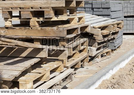 Packed And Laid On Wooden Pallets New Construction Tiles For Laying Paths And Roads, For Repairing A