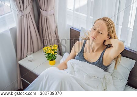 Upset Young Woman Lying In Bed In Morning Feels Pain In Neck After Night Sleep, Awaken Having Painfu