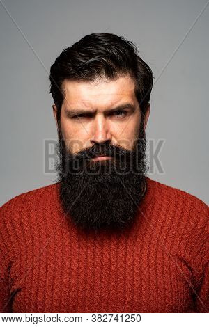 Confident Serious Man Looks Seriously, Isolated. Hipster Guy Models In Studio. Businessman Thinking